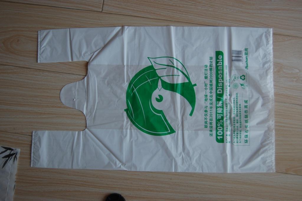 【绿色纸背心袋-环保新材料-石头v绿色横空出世钧鱼伞图片